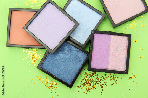 Beautiful bright eye shadows on green background