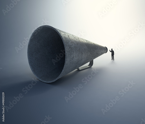 Man speaking through a vintage megaphone