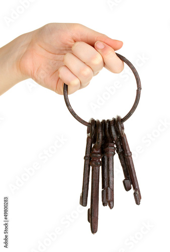 Bunch of old keys in hand isolated on white