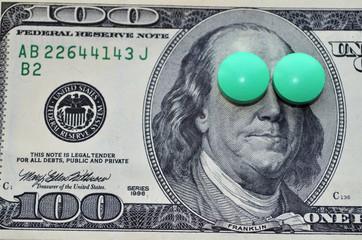 Доллары и зелёные таблетки.