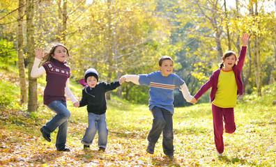 Happy kids and autumn leaves