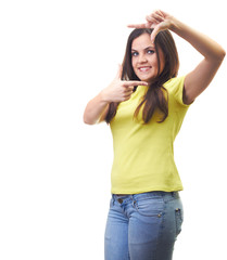 Attractive smiling young woman in a yellow shirt shows a frame w