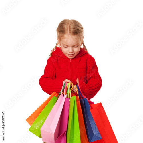 Shopping little girl holding a many shopping bags.