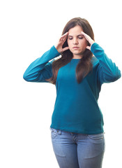 Attractive young woman in a blue shirt suffering from a headache