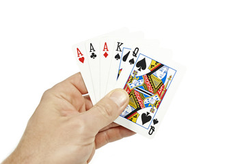 Poker player holding three of a kind