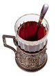 black tea in vintage glass with teaspoon