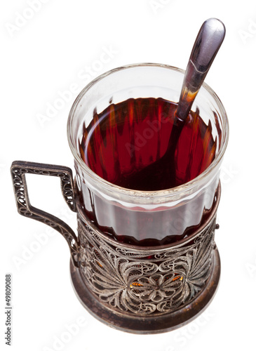 black tea in vintage glass with teaspoon