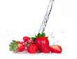 Fresh strawberries with water splash on white background