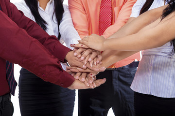 Close-up of business team join hands