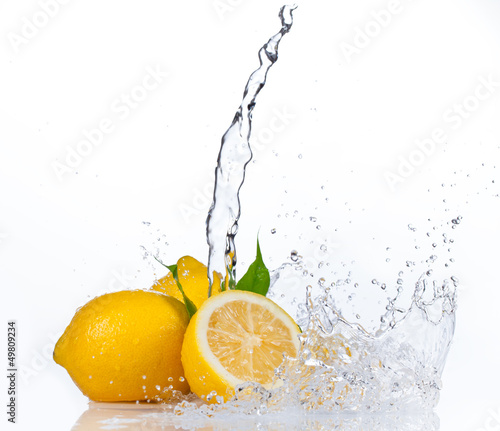 Poster Opspattend water Fresh lemons with water splash, isolated on white background