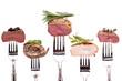 Leinwandbild Motiv Verschiedene Sorten Fleisch auf einer Gabel