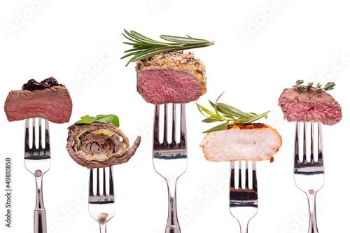 Plexiglas Kruidenierswinkel Verschiedene Sorten Fleisch auf einer Gabel