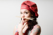 beautiful tattooed pinup cook girl with spaghetti