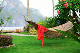 Hammock with red pareo on a tropical resort poster
