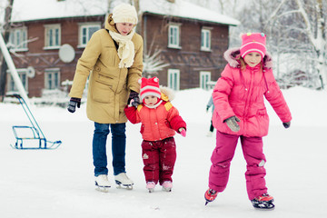 Mom and her daughters skating