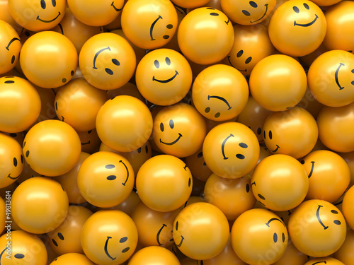 yellow balls with funny smiley faces