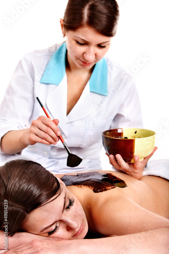 Woman having chocolate body mask.