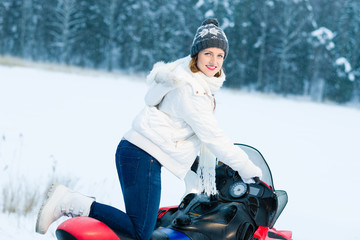 Woman and snowmobile