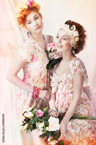 Freshness. Women in Vintage Dresses with Flowers. Pin-up Style