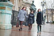 Three happy girls walking together in Paris