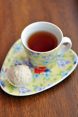 Small cup of tea and a raffaello