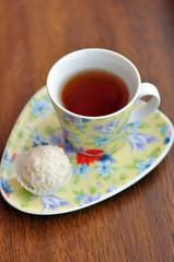 Small cup of tea and a raffaello