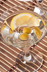 martini with olives and lemon