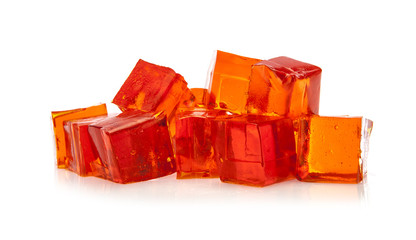 Orange jelly cubes on white background