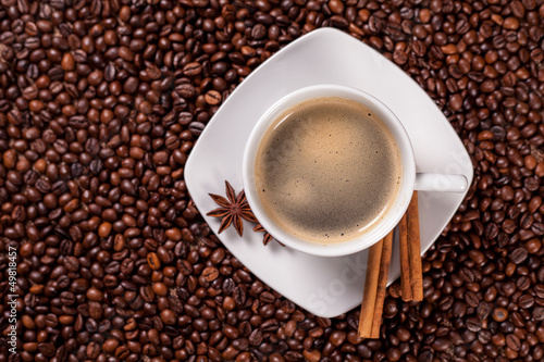 High angle view of a coffee cup with cinnamon