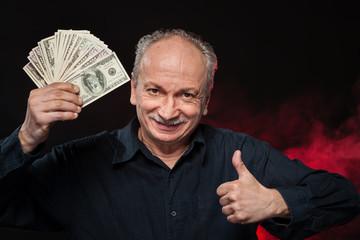 old man with dollar bills