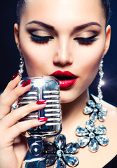 Singer Woman with Retro Microphone. Vintage Style © Subbotina Anna