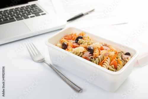 Eating a pasta salad in the office