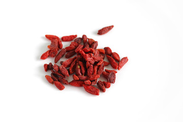 Dried Goji berries or cranberries fruit isolated on white