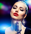 Singer Woman with Retro Microphone. Vintage Style