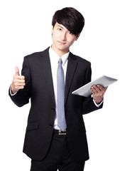 young business man thumb up with touch pad