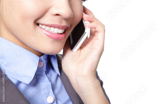 close up of business woman speaks phone