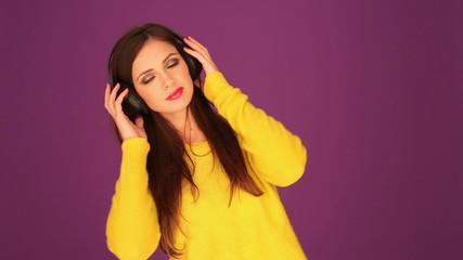 Beautiful woman listening music through headphone
