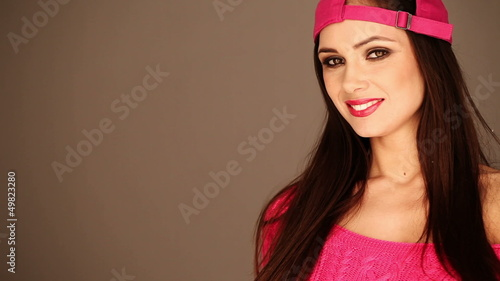 Close up portrait of smiling gorgeous woman wearing pink