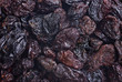 dark dried raisins  close- up food background