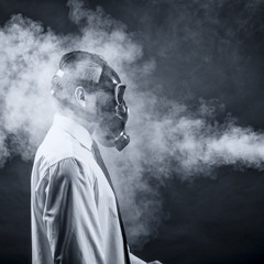 a man in a gas mask goes through the smoke