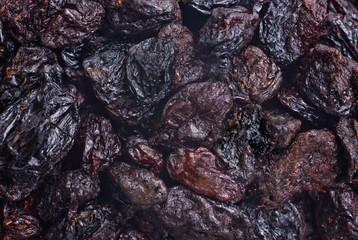dark dried raisins  close- up food background
