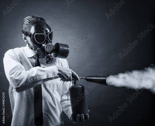 man in a gas mask and a fire extinguisher in his hands