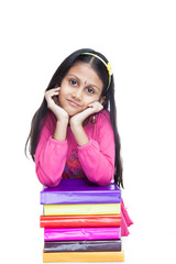 Young indian girl student holding her hands on books. Isolated o