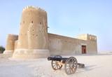 A vintage canon & Zubarah fort, Qatar