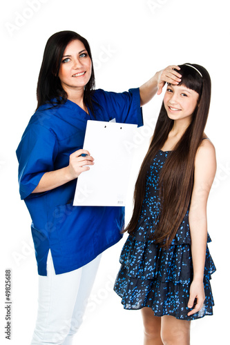 beautiful girl with a doctor in a blue robe