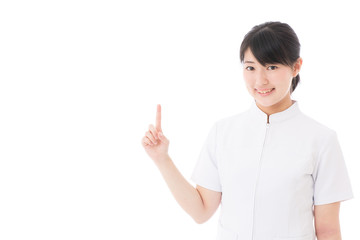a young asian nurse showing on white background