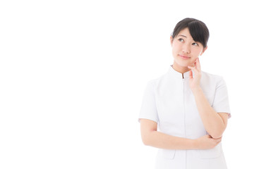 a young asian nurse thinking on white background