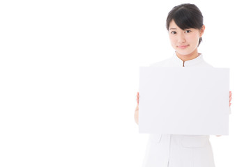a young asian nurse on white background
