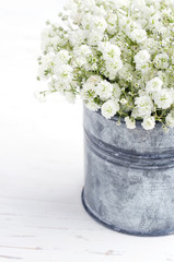 Bouquet of baby's breath flowers, on wooden background