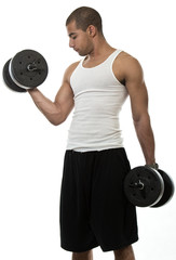 Attractive hispanic african american man lifting weights